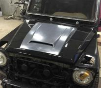 Tuning External New trim on the hood BRABUS Wide Star for G-Class W463